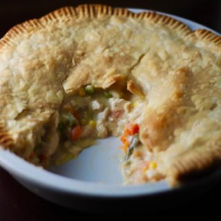 This weeknight Chicken Pot Pie recipe has a buttery, flaky crust surrounding a warm, creamy, dreamy gravy with tender chicken & veggies. What's not to love!   sarahnspice.com