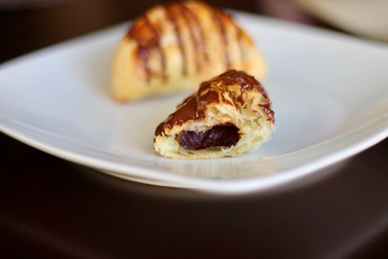 These Chocolate Hand Pies have a crispy, flaky pastry surrounding a smooth and creamy chocolate center, drizzled with even more chocolate! | sarahnspice.com