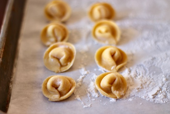 homemade-tortellini-A step-by-step guide to making your very own Homemade Tortellini. While labor intensive, it's a lot of fun and absolutely worth it! | sarahnspice.comws