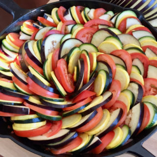 Ratatouille is an array of colorful vegetables on top of a savory tomato sauce, baked to perfection. A hearty dish that's as tasty as it is stunning! | sarahnspice.com
